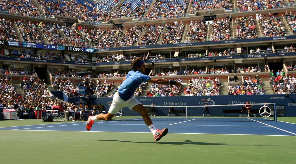 . Roger Federer, of Switzerland, returns a shot to Carlos Berlocq, of Argentina, during the second round of the 2013 U.S. Open tennis tournament, Thursday, Aug. 29, 2013, in New York. (AP Photo/Kathy Willens)