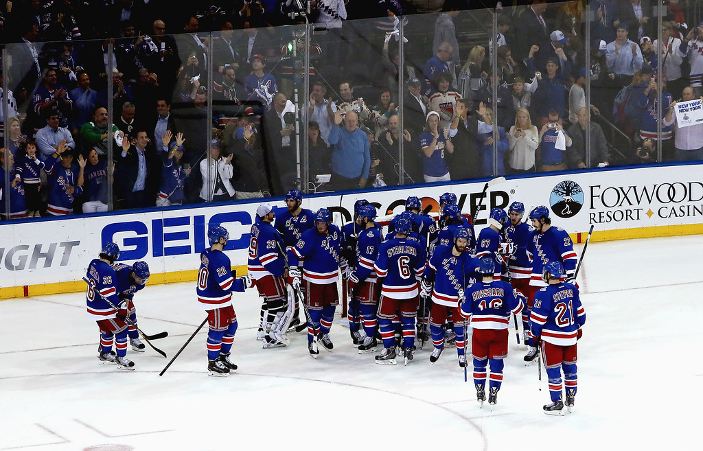. The New York Rangers celebrate after defeating the Los Angeles Kings 2-1 in Game Four of the 2014 NHL Stanley Cup Final at Madison Square Garden on June 11, 2014 in New York, New York.  (Photo by Jim McIsaac/Getty Images)