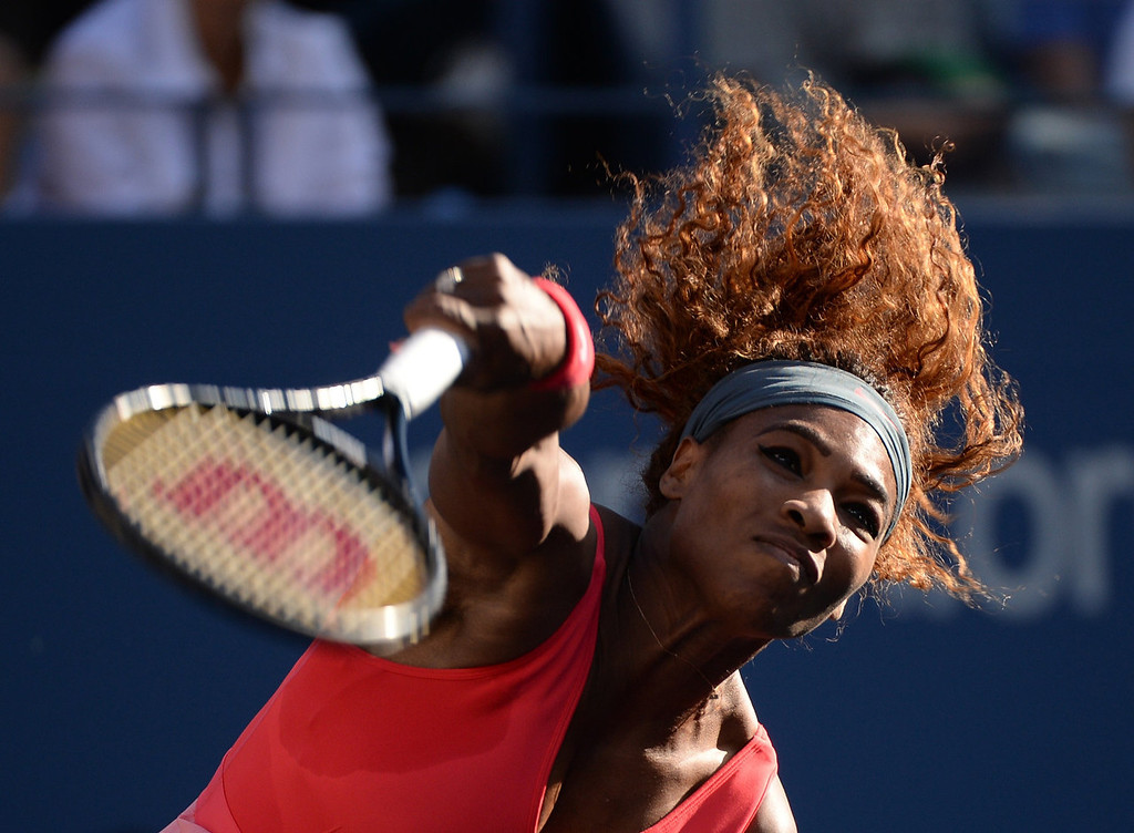 . Serena Williams of the US serves to Victoria Azarenka of Belarus during their 2013 US Open women\'s singles final match at the USTA Billie Jean King National Tennis Center September 8, 2013 in New York.  STAN HONDA/AFP/Getty Images