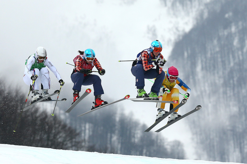 . (L-R) Ophelie David of France, Kelsey Serwa of Canada, Marielle Thompson of Canada and Anna Holmlund of Sweden compete in the Freestyle Skiing Womens\' Ski Cross Final on day 14 of the 2014 Winter Olympics at Rosa Khutor Extreme Park on February 21, 2014 in Sochi, Russia.  (Photo by Cameron Spencer/Getty Images)