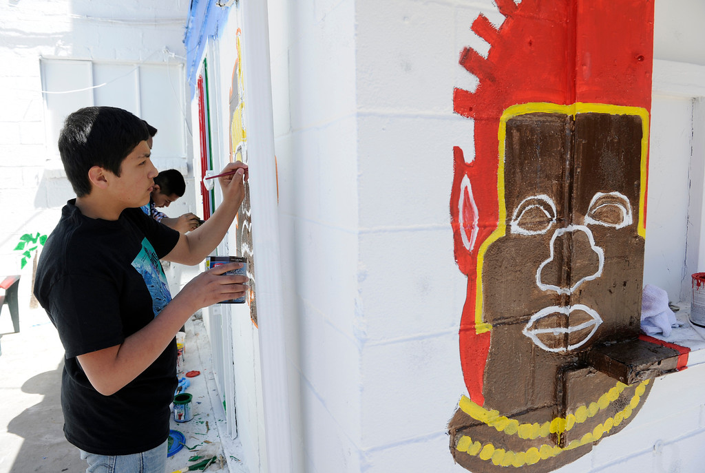 . DENVER, CO - MAY 3: Cristian Lomeli, 14, joins a group of his ninth-grade classmates from Bruce Randolph School to perform a day of service in the Five Points neighborhood by painting multicultural murals to celebrate the diverse cultures of the Five Points community. The ninth-grade class was divided in to groups and participated in various service jobs in four different locations in Denver during the day. (Photo By Kathryn Scott Osler/The Denver Post)