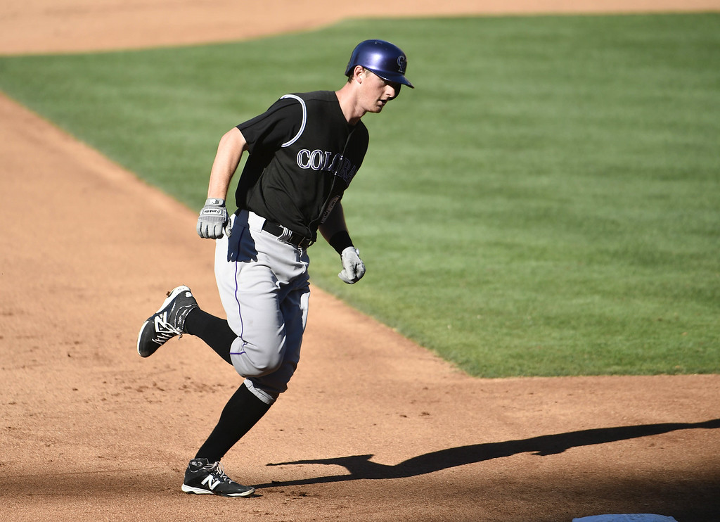 . SAN DIEGO, CA - AUGUST 13:  DJ LeMahieu #9 of the Colorado Rockies rounds the bases after hitting a solo home run during the fifth inning of a baseball game against the San Diego Padres at Petco Park on August 13, 2014 in San Diego, California.  (Photo by Denis Poroy/Getty Images)