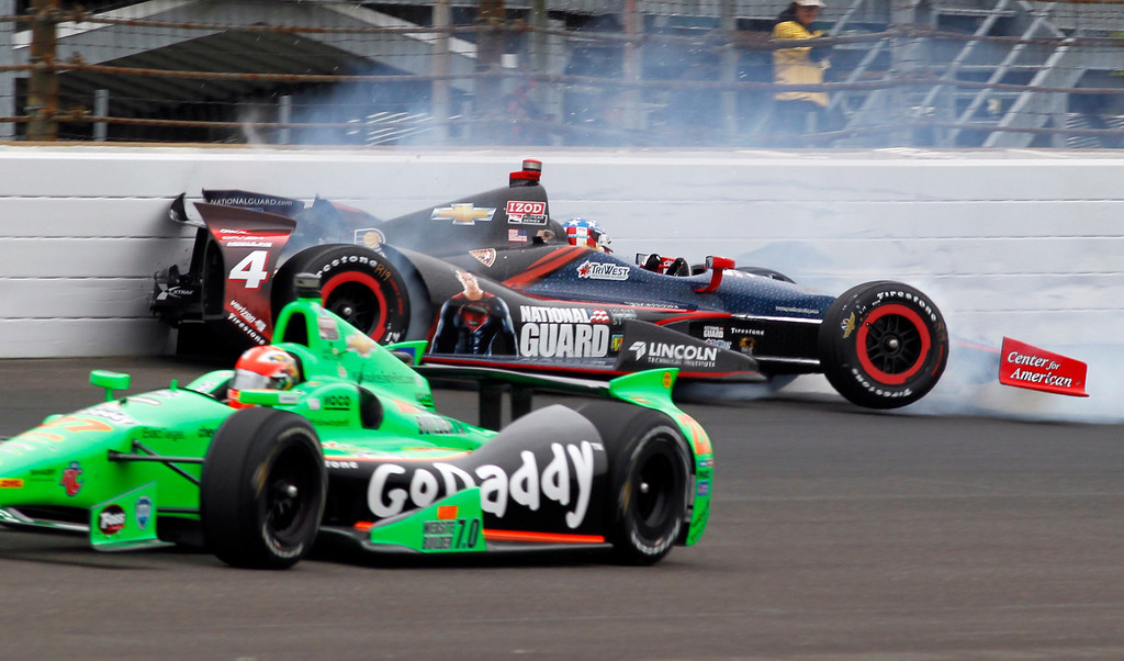 . James Hinchcliffe, of Canada, bottom, goes under as JR Hildebrand hits the wall in the first turn during the Indianapolis 500 auto race at the Indianapolis Motor Speedway in Indianapolis Sunday May 26, 2013. (AP Photo/Bill Friel)