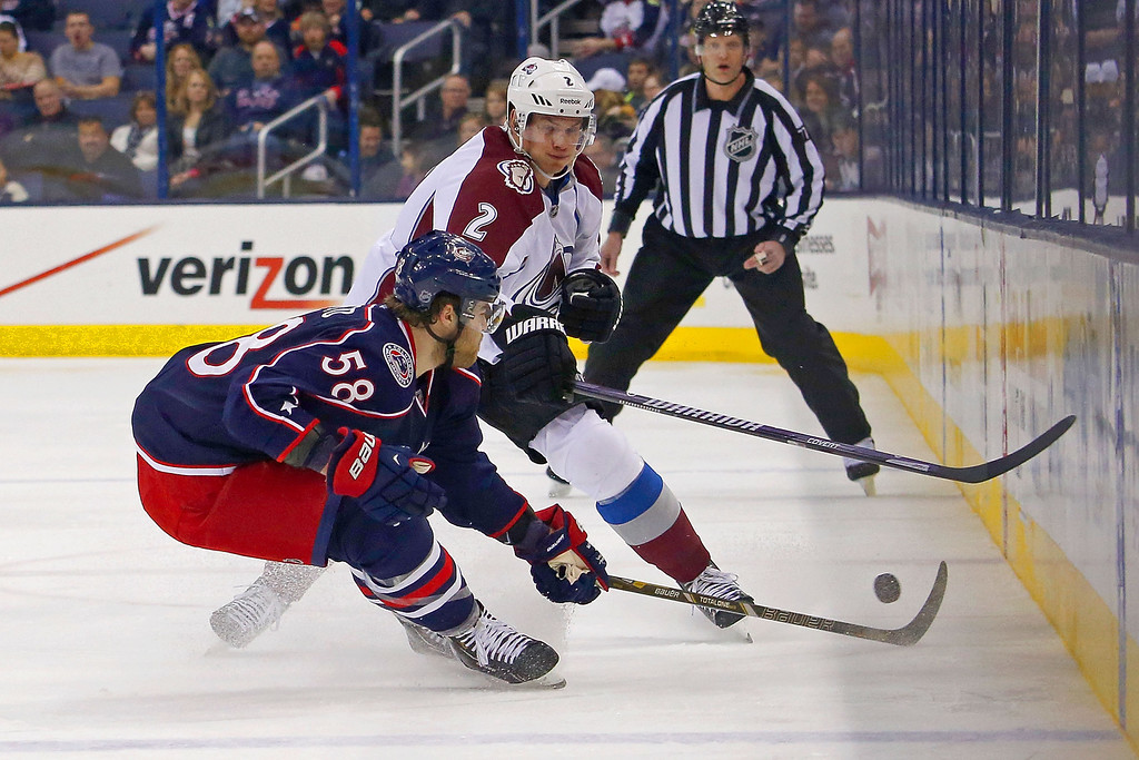 . COLUMBUS, OH - APRIL 1:  Nick Holden #2 of the Colorado Avalanche flips the puck past David Savard #58 of the Columbus Blue Jackets during the first period on April 1, 2014 at Nationwide Arena in Columbus, Ohio. (Photo by Kirk Irwin/Getty Images)