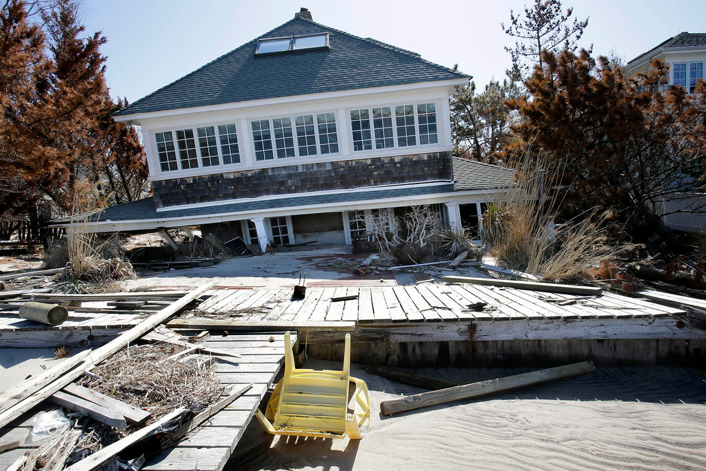 . A home rests along Barnegat Bay, Thursday, April 25, 2013, in Mantoloking, N.J., after it was severely damaged last October by Superstorm Sandy. Six months after Sandy devastated the Jersey shore and New York City and pounded coastal areas of New England, the region is dealing with a slow and frustrating, yet often hopeful, recovery. (AP Photo/Mel Evans)