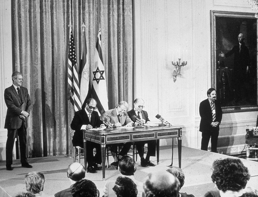 . L-R: Egyptian president Anwar el-Sadat, US president Jimmy Carter and Israeli prime minister Menachem Begin sign the Egyptian - Israeli peace agreement at the White House, Washington DC, 1978. (Photo by Hulton Archive/Getty Images)