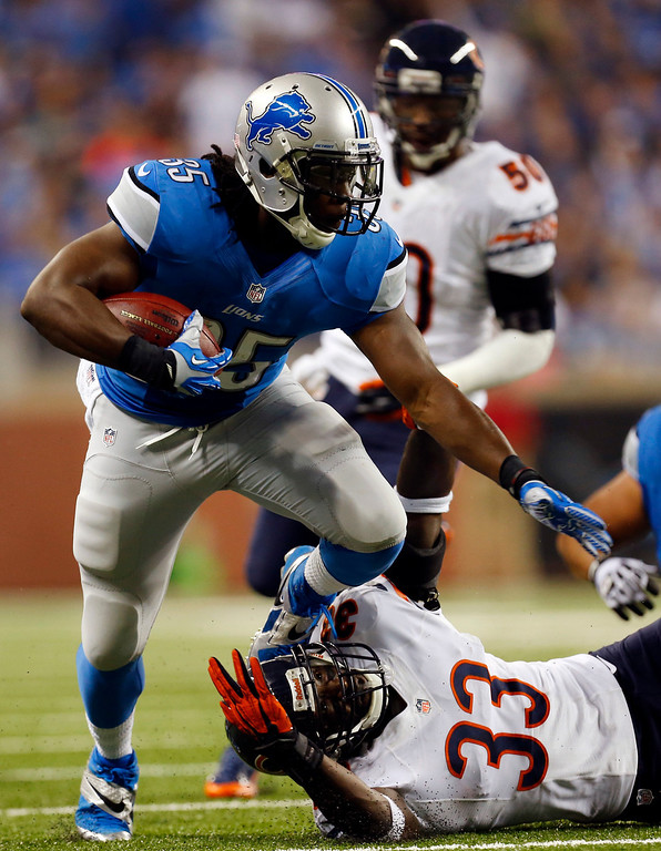 . Detroit Lions running back Joique Bell (35) pulls away from Chicago Bears cornerback Charles Tillman (33) during the first quarter of an NFL football game at Ford Field in Detroit, Sunday, Sept. 29, 2013. (AP Photo/Paul Sancya)
