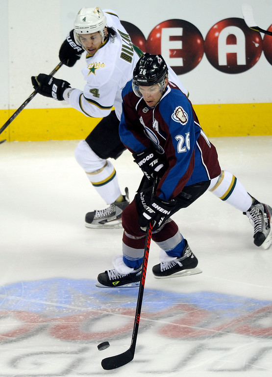 . DENVER, CO. - MARCH 12: Paul Stastny (26) of the Colorado Avalanche tried to get past Brenden Dillon (4) of the Dallas Stars in the first period. The Colorado Avalanche hosted the Dallas Stars Wednesday night, March 19, 2013 at the Pepsi Center in Denver. (Photo By Karl Gehring/The Denver Post)