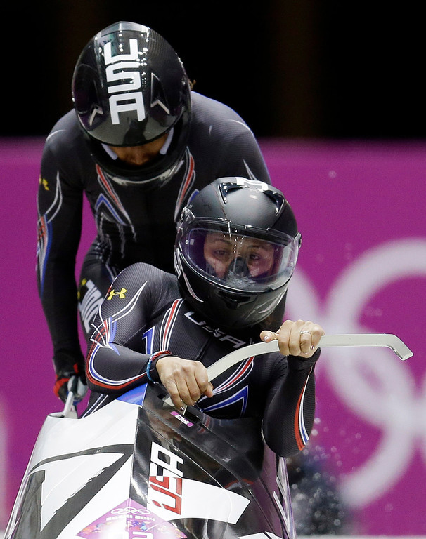 . The team from the United States USA-1, piloted by Elana Meyers with brakeman Lauryn Williams, start their first run during the women\'s two-man bobsled competition at the 2014 Winter Olympics, Tuesday, Feb. 18, 2014, in Krasnaya Polyana, Russia. (AP Photo/Natacha Pisarenko)