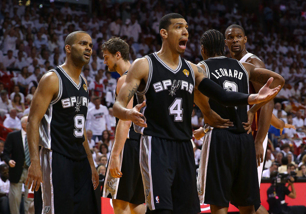 . (L-R) Tony Parker #9 and Danny Green #4 of the San Antonio Spurs react in the first quarter while taking on the Miami Heat during Game One of the 2013 NBA Finals at AmericanAirlines Arena on June 6, 2013 in Miami, Florida. (Photo by Mike Ehrmann/Getty Images)