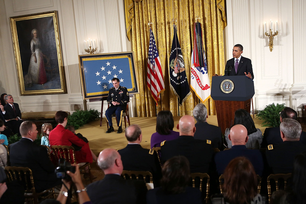 . U.S. President Barack Obama (R) speaks prior to presenting the Medal of Honor for conspicuous gallantry to Clinton Romesha (L), a former active duty Army Staff Sergeant, at the White House February 11, 2013 in Washington, DC. (Photo by Alex Wong/Getty Images)