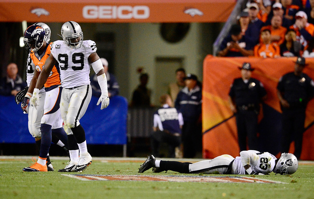 . Oakland Raiders cornerback Tracy Porter (23) takes some extra time to get up in the third quarter. The Denver Broncos took on the Oakland Raiders at Sports Authority Field at Mile High in Denver on September 23, 2013. (Photo by AAron Ontiveroz/The Denver Post)