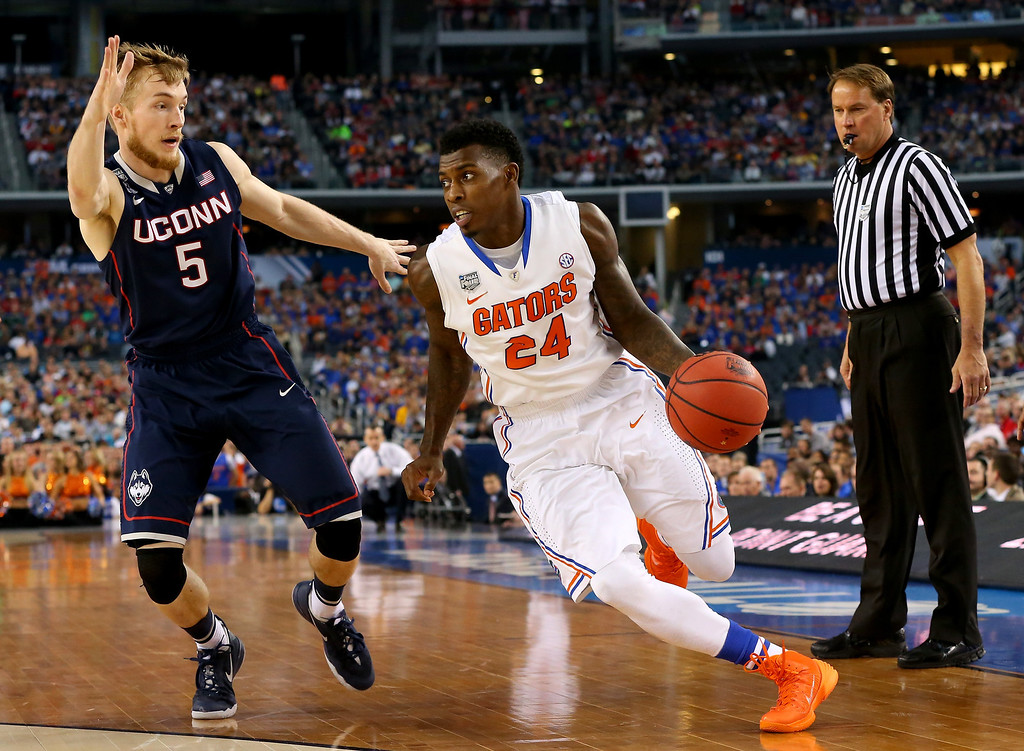 . ARLINGTON, TX - APRIL 05: Casey Prather #24 of the Florida Gators drives to the basket as Niels Giffey #5 of the Connecticut Huskies defends during the NCAA Men\'s Final Four Semifinal at AT&T Stadium on April 5, 2014 in Arlington, Texas.  (Photo by Ronald Martinez/Getty Images)