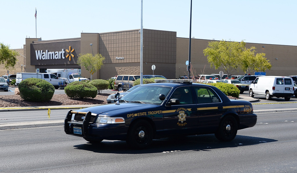 . A Nevada Highway Patrol vehicle drives by outside a Wal-Mart on June 8, 2014 in Las Vegas, Nevada. Two Las Vegas  Metropolitan Police Department officers were reported shot and killed by two assailants at a pizza restaurant near the Wal-Mart.  (Photo by Ethan Miller/Getty Images)