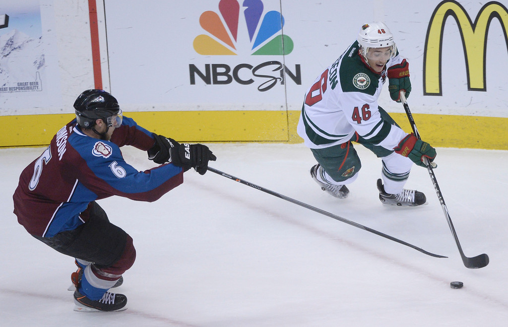 . Erik Johnson (6) of the Colorado Avalanche and Jared Spurgeon (46) of the Minnesota Wild fight for the puck during the first period of action.   (Photo by Karl Gehring/The Denver Post)