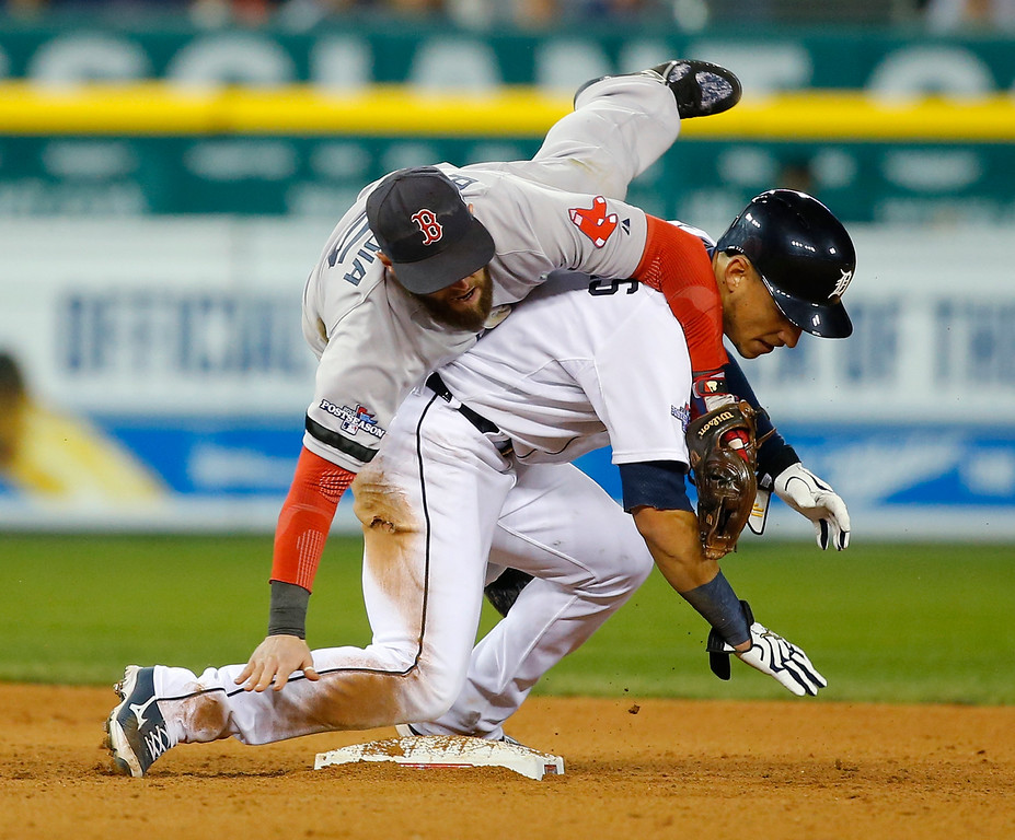 . Boston Red Sox second baseman Dustin Pedroia collides with Detroit Tigers\' Jose Iglesias as Pedroia tags Iglesias out on double play in sixth inning during Game 4 of the American League baseball championship series Wednesday, Oct. 16, 2013, in Detroit. (AP Photo/Paul Sancya)