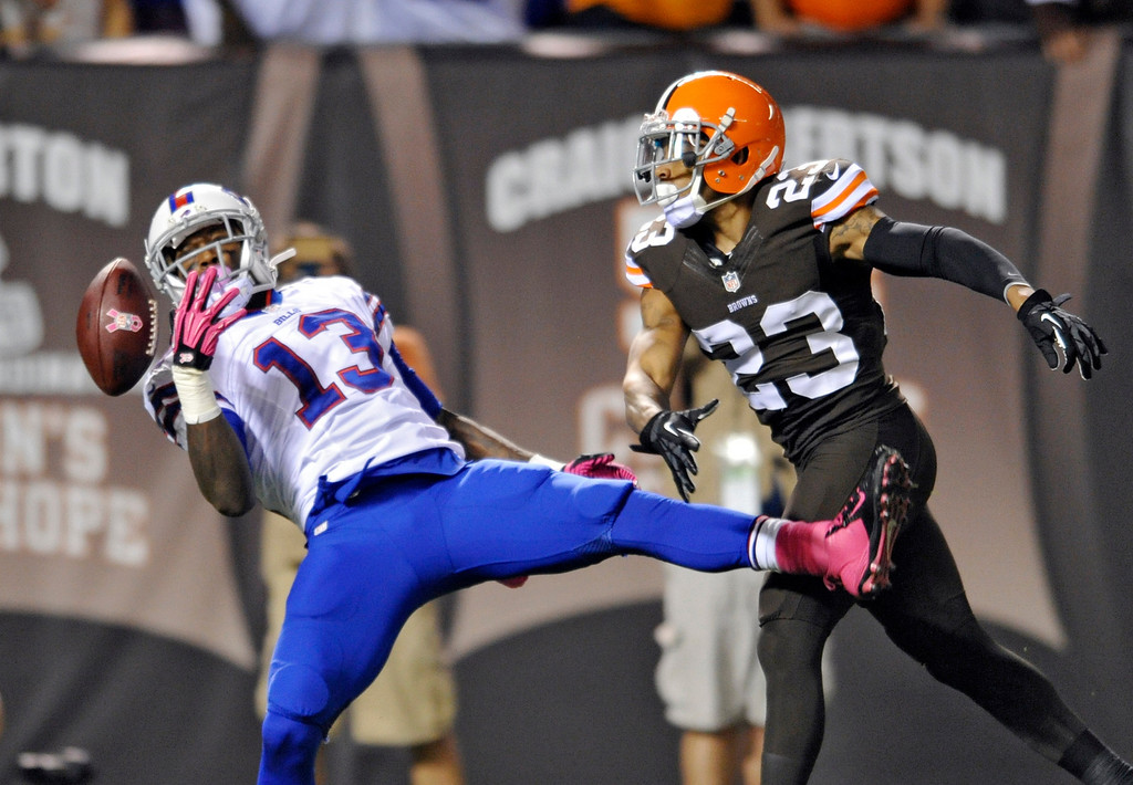 . Cleveland Browns cornerback Joe Haden (23) breaks up a pass for Buffalo Bills wide receiver Stevie Johnson (13), but is called for pass interference in the first quarter of an NFL football game Thursday, Oct. 3, 2013, in Cleveland. (AP Photo/David Richard)