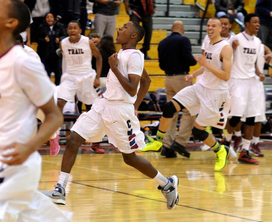 . The Cougars reacted after the buzzer beating put back by guard Solomon Yon was good. The Cherokee Trail boy\'s basketball team defeated Overland 59-57 Friday night, January 11, 2013. Karl Gehring/The Denver Post