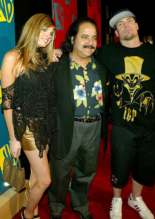 ". (L-R) Actress Trishelle Canatella, Actor Ron Jeremy, and Singer Rob ""Vanilla Ice\"" Van Winkle arrive to The WB Networks 2004 All-Star Winter Party on January 13, 2004 at the Hollywood and Highland Mall, in Hollywood, California. (Photo by Kevin Winter/Getty Images)"
