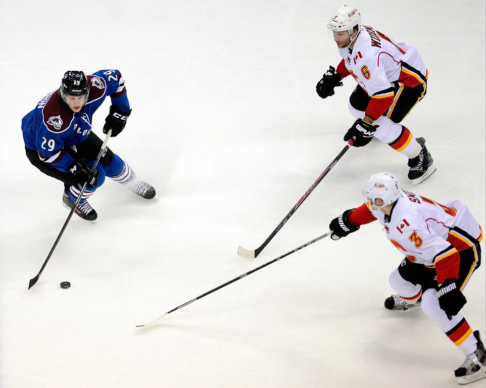 . Nathan MacKinnon (29) of the Colorado Avalanche controls the puck as Dennis Wideman (6) of the Calgary Flames and Ladislav Smid (3) of the Calgary Flames defend during the second period.   (Photo by AAron Ontiveroz/The Denver Post)