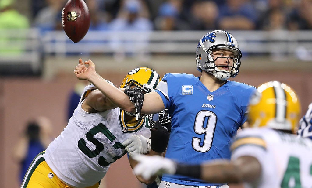 . Nick Perry #53 of the Green Bay Packers hits the throwing arm of Matthew Stafford #9 of the Detroit Lions causing a fumble during the second quarter of the game  at Ford Field on November 28, 2013 in Detroit, Michigan.  (Photo by Leon Halip/Getty Images)