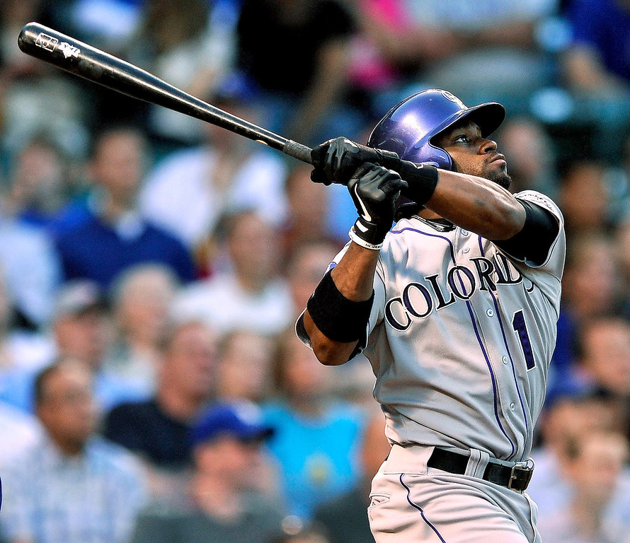 . Colorado Rockies\' Eric Young Jr. watches his two-run home run against the Chicago Cubs during the second inning of a baseball game in Chicago, Tuesday, May 14, 2013. (AP Photo/Paul Beaty)
