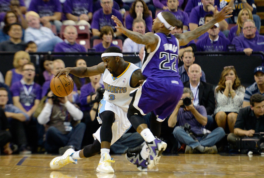 . SACRAMENTO, CA - OCTOBER 30:  Isaiah Thomas #22 of the Sacramento Kings collides with Ty Lawson #3 of the Denver Nuggets during the fourth quarter at Sleep Train Arena on October 30, 2013 in Sacramento, California. NOTE TO USER: User expressly acknowledges and agrees that, by downloading and or using this photograph, User is consenting to the terms and conditions of the Getty Images License Agreement. The Kings won the game 90-88  (Photo by Thearon W. Henderson/Getty Images)