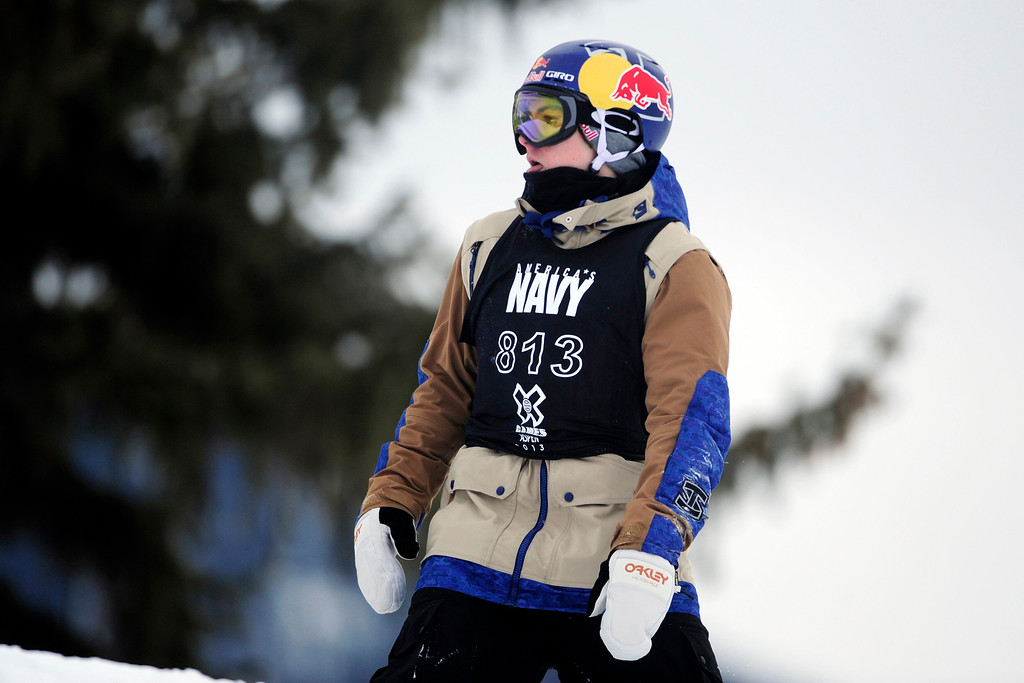 . ASPEN, CO. - JANUARY 24: Sebastian Toutant reacts to falling during the men\'s Snowboard Slopestyle elimination. Men\'s Snowboard Slopestyle elimination X Games Aspen Buttermilk Mountain Aspen January 24, 2013. (Photo By AAron Ontiveroz / The Denver Post)