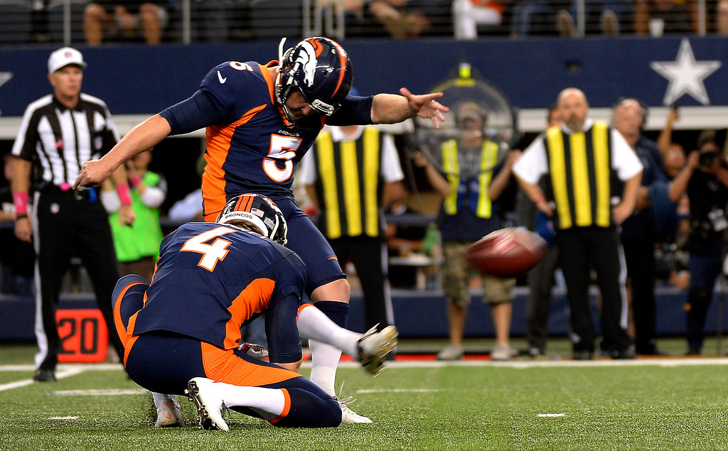 . Kicker Matt Prater #5 of the Denver Broncos nails the winning field goal to give the Broncos a 51-48 win over the Dallas Cowboys. (Photo By Joe Amon/The Denver Post)