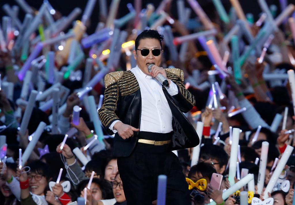 ". South Korean rapper PSY performs at his concert \""Happening\"" in Seoul, South Korea Saturday, April 13, 2013. (AP Photo/Kin Cheung)"