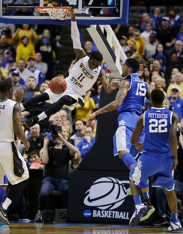 . Wichita State forward Cleanthony Early (11) dunks against Kentucky  during the first half of a third-round game of the NCAA college basketball tournament Sunday, March 23, 2014, in St. Louis. (AP Photo/Jeff Roberson)