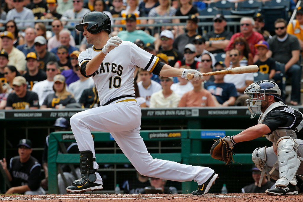. Pittsburgh Pirates\' Jordy Mercer (10) singles to center driving in two runs off Colorado Rockies starting pitcher Tyler Matzek during the second inning of a baseball game in Pittsburgh Sunday, July 20, 2014. (AP Photo/Gene J. Puskar)