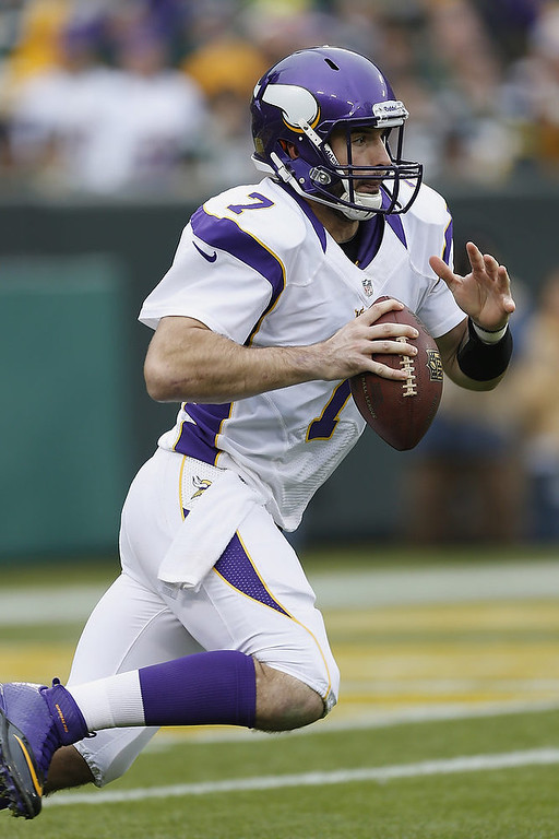 . Christian Ponder #7 of the Minnesota Vikings runs the ball against the Green Bay Packers at Lambeau Field on December 2, 2012 in Green Bay, Wisconsin.  The Packers defeated the Vikings 23-14.  (Photo by Wesley Hitt/Getty Images)