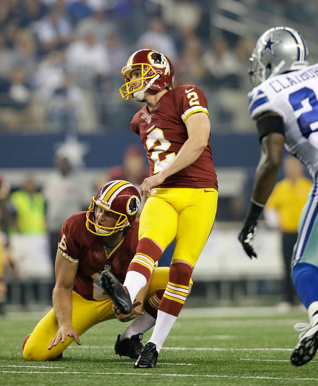 . Washington Redskins kicker Kai Forbath (2) and punter Sav Rocca (6) watch Forbath\'s field goal as Dallas Cowboys cornerback Morris Claiborne, right, pressures in the final seconds of the first half of an NFL football game, Sunday, Oct. 13, 2013, in Arlington, Texas. (AP Photo/Tim Sharp)