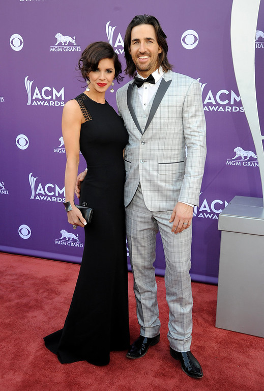 . Jake Owen, right, and Lacey Buchanan arrive at the 48th Annual Academy of Country Music Awards at the MGM Grand Garden Arena in Las Vegas on Sunday, April 7, 2013. (Photo by Al Powers/Invision/AP)