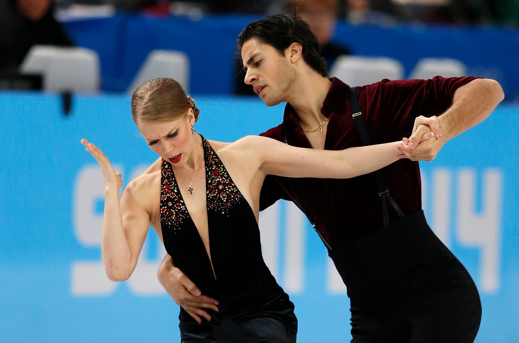 . Canada\'s Kaitlyn Weaver and Canada\'s Andrew Poje perform in the Figure Skating Ice Dance Free Dance at the Iceberg Skating Palace during the Sochi Winter Olympics on February 17, 2014.  ADRIAN DENNIS/AFP/Getty Images