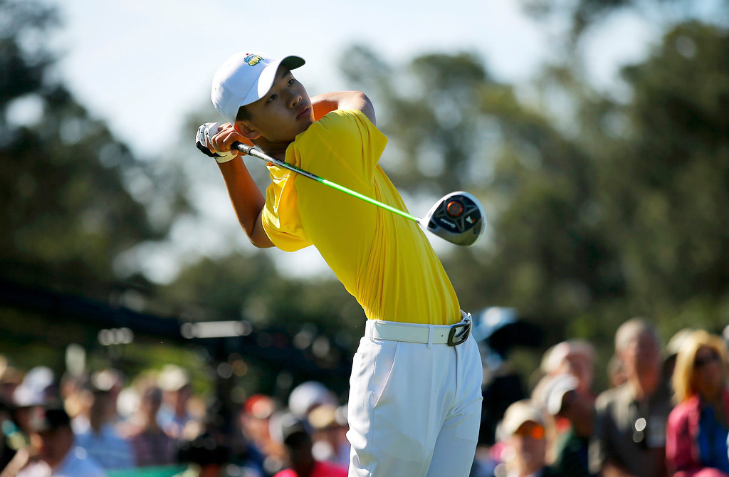 . Amateur Guan Tianlang of China hits his tee shot on the first hole during third round play in the 2013 Masters golf tournament at the Augusta National Golf Club in Augusta, Georgia, April 13, 2013.  REUTERS/Brian Snyder