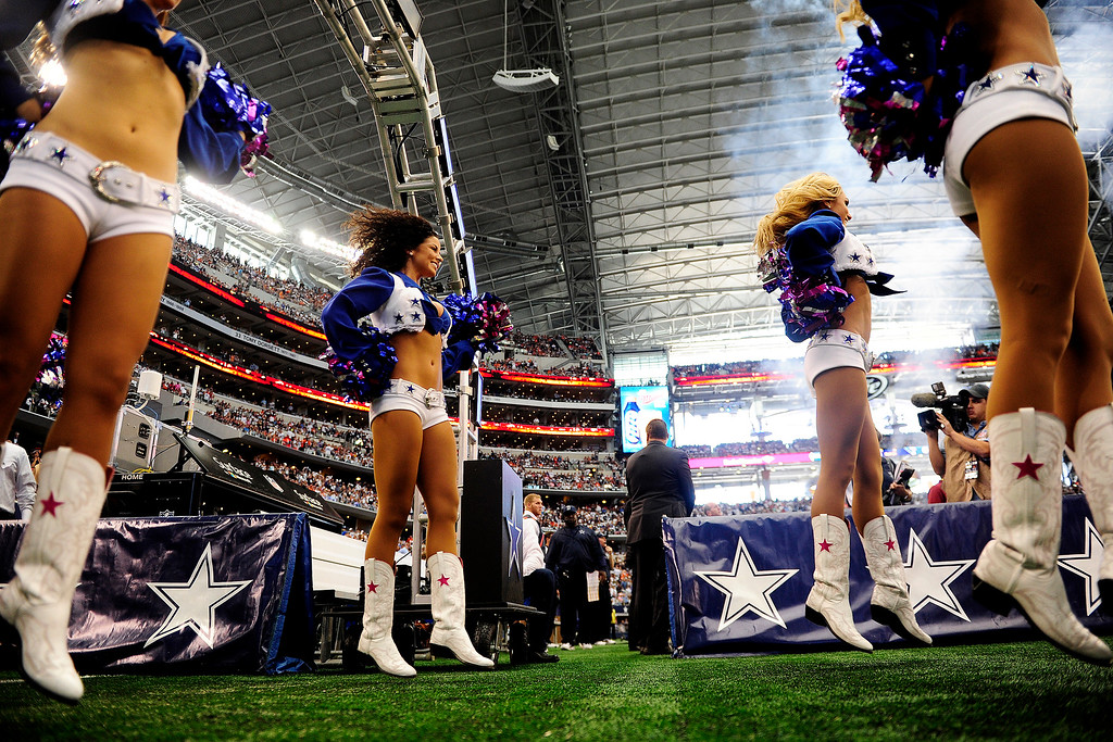 . The Dallas Cowboys cheerleaders lead the team onto the field before the first half of action at AT&T Stadium. The Denver Broncos visit the Dallas Cowboys. (Photo by AAron Ontiveroz/The Denver Post)