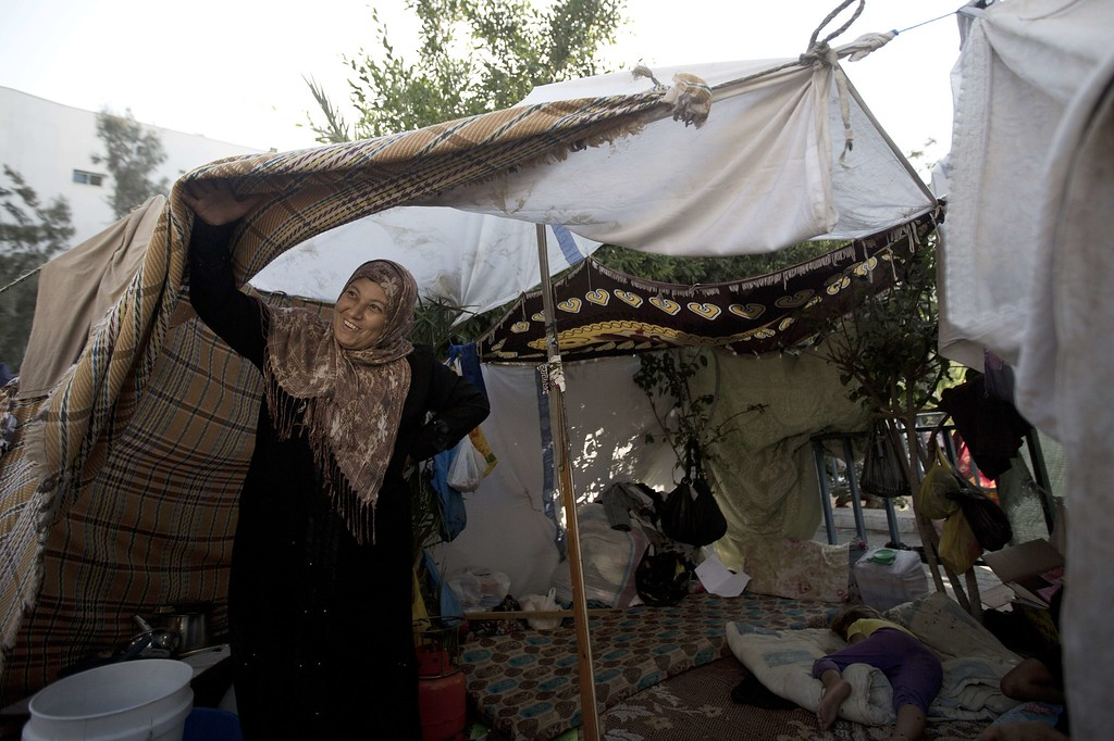 . Displaced Palestinians take shelter at the al-Shifa hospital in Gaza City after fleeing attacks in the Shejaiya neighborhood of the city, on July 31, 2014. With more than 220,000 Palestinians already sheltering in UN facilities -- four times the number from the last Gaza conflict in 2008-2009 -- the top UN refugee official Philippe Krahenbuhl said he had reached breaking point. AFP PHOTO / MAHMUD HAMS/AFP/Getty Images