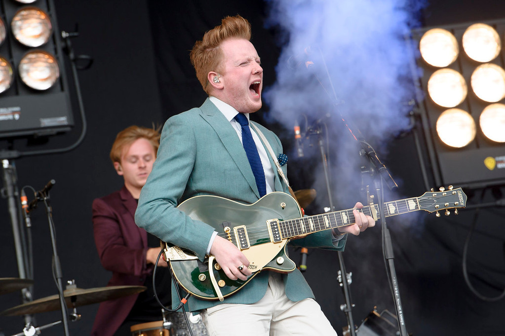 . Alex Trimble from British band Two Door Cinema Club performs at the V Festival in Chelmsford, Essex, Saturday, Aug. 17, 2013. (Photo by Jonathan Short/Invision/AP)