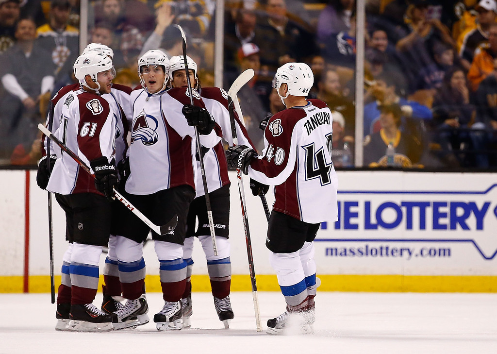 . Ryan O\'Reilly #90 of the Colorado Avalanche celebrates with teammates following his goal in the first period against the Boston Bruins during the game on October 10, 2013 at TD Garden in Boston, Massachusetts. (Photo by Jared Wickerham/Getty Images)