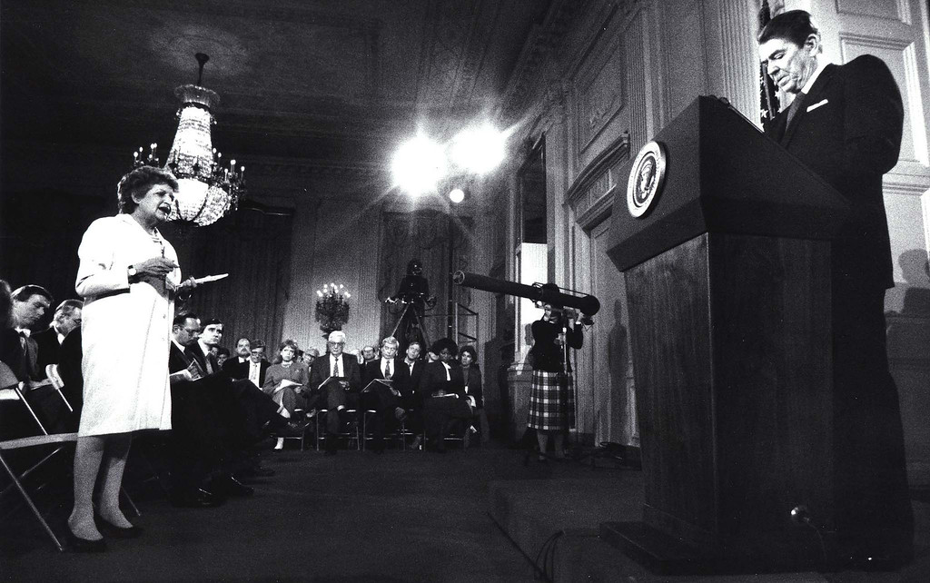 . WASHINGTON, DC - MARCH 19:  This file photo shows reporter Helen Thomas as she questions former US President Ronald Reagan during a press conference at the White House 19 March,1987 in Washington, DC. This was the first press conference that Reagan had held since 19 November 1986, six days before the disclosure that profits from arm sales to Iran were diverted to the Contras.  DON RYPKA/AFP/Getty Images