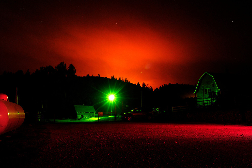 . A 10-second exposure of the sky as seen from a staging area at the Western Ranch Restaurant on Thursday, June 14, 2012. The fire has now burned more than 40,000 acres encompassing more than 65 square miles. AAron Ontiveroz, The Denver Post
