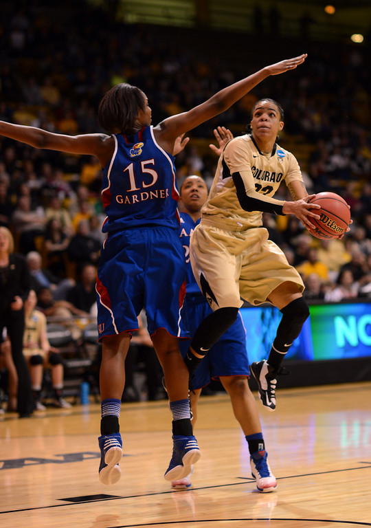 . BOULDER, CO. - MARCH 23: Chucky Jeffery of Colorado Buffaloes (23), right, drives against Chelsea Gardner of Kansas Jayhawks (15), left, during the first round of the 2013 NCAA women\'s Basketball Tournament at Coors Events Center. Boulder, Colorado. March 23, 2013. Kansas won 67-52. (Photo By Hyoung Chang/The Denver Post)