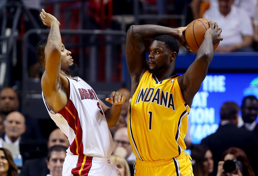 . MIAMI, FL - MAY 30: Lance Stephenson #1 of the Indiana Pacers looks to pass as Rashard Lewis #9 of the Miami Heat defends during Game Six of the Eastern Conference Finals of the 2014 NBA Playoffs at American Airlines Arena on May 30, 2014 in Miami, Florida.  (Photo by Mike Ehrmann/Getty Images)