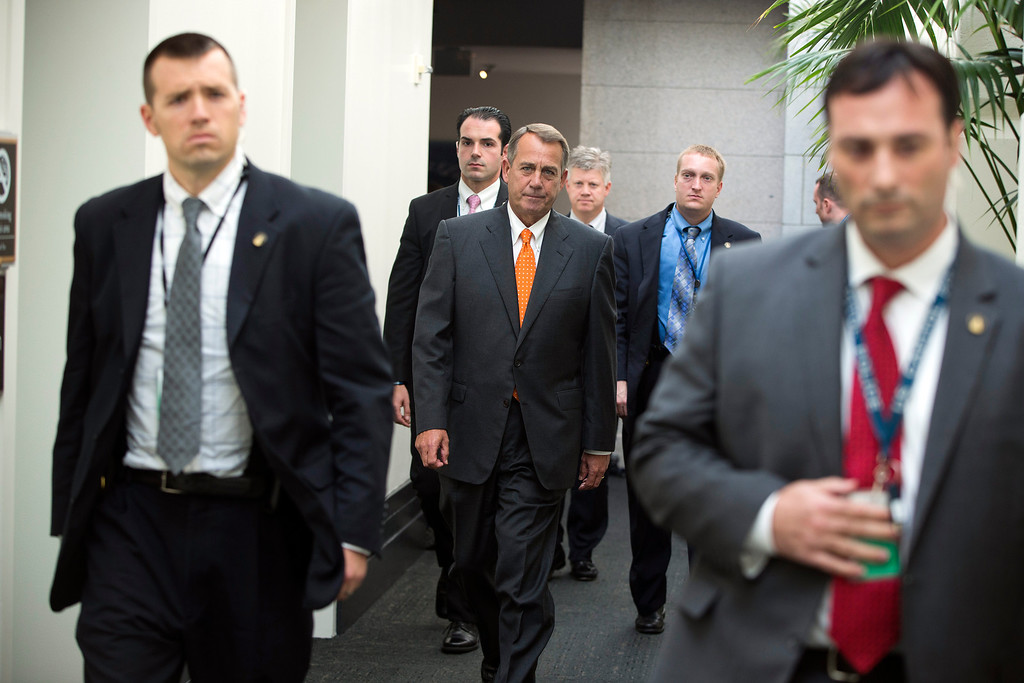 . Speaker of the House Rep. John Boehner, R-Ohio, walks to a meeting with House Republicans on Capitol Hill on Wednesday, Oct. 16, 2013 in Washington. Senate leaders announced last-minute agreement Wednesday to avert a threatened Treasury default and reopen the government after a partial, 16-day shutdown. (AP Photo/ Evan Vucci)