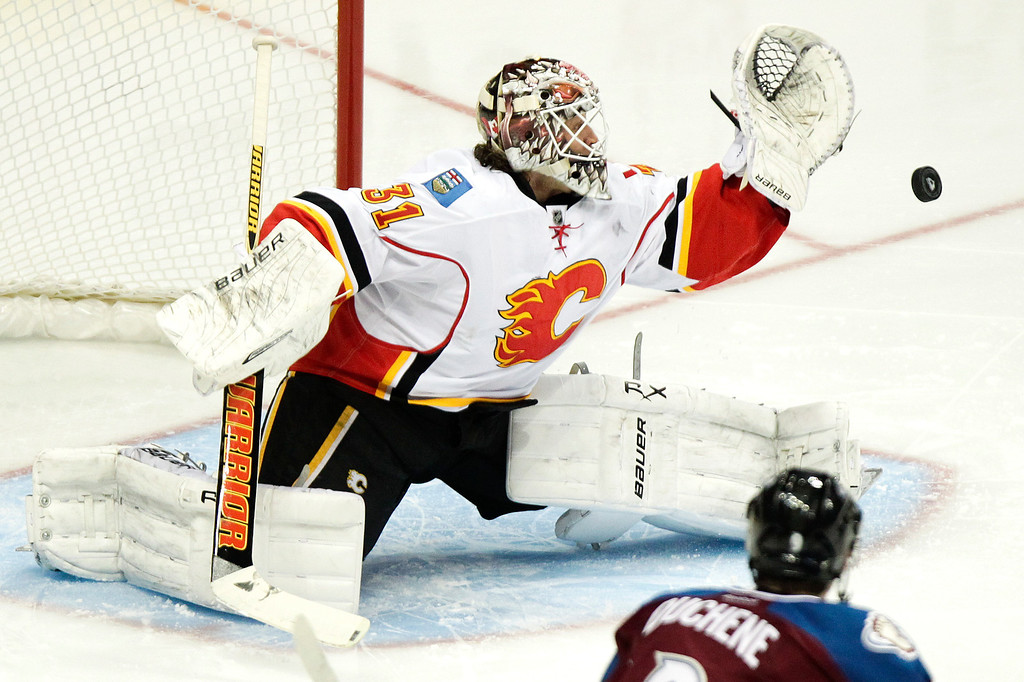 . Calgary Flames goalie Karri Ramo (31), of Finland, makes a save during the first period of an NHL hockey game against the Colorado Avalanche, Friday, Nov. 8, 2013, in Denver. (AP Photo/Barry Gutierrez)