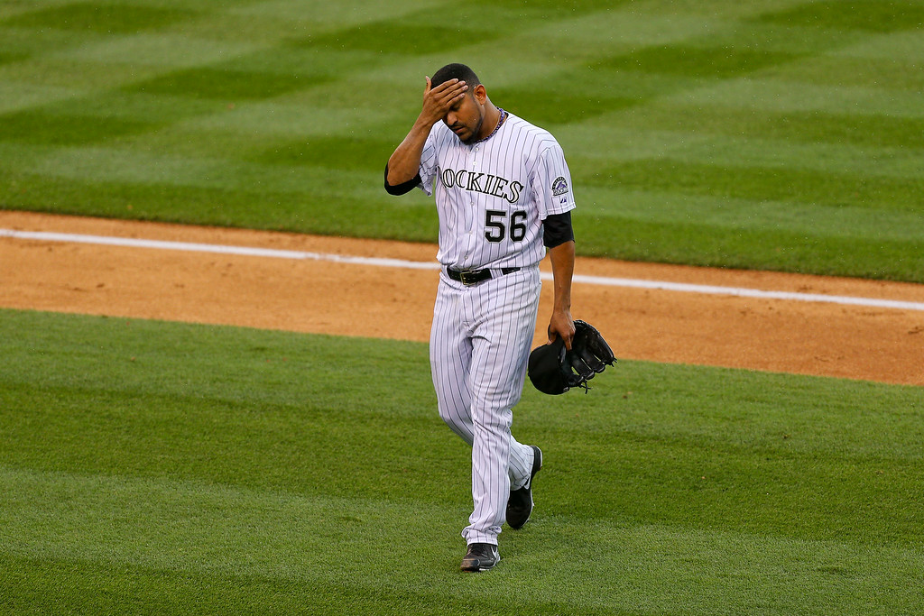 . Starting pitcher Franklin Morales #56 of the Colorado Rockies walks off the field after giving up a run during the third inning against the Los Angeles Dodgers at Coors Field on July 3, 2014 in Denver, Colorado.  (Photo by Justin Edmonds/Getty Images)