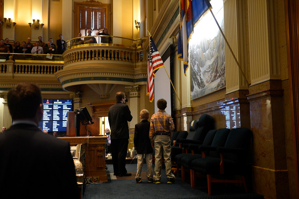 . DENVER, CO. - FEBRUARY 15: Representative Mark Ferrandino Speaker of the Colorado House of Representatives with 6 year old Silas Smith and his older brother 10 year old Owen lead the Pledge of Allegiance before debate of four bills that seek to enact universal gun background checks, fees for background checks, limits on magazine size and a ban on conceal carry permits on college campuses at the Denver State Capitol February 15, 2013. Denver, Colorado. (Photo By Joe Amon/The Denver Post)