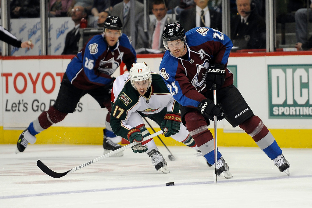 . Milan Hejduk (23) of the Colorado Avalanche carries the puck into the zone as he is pressured by Torrey Mitchell (17) of the Minnesota Wild during the first period, Saturday, April 27, 2012 at Pepsi Center. Seth A. McConnell, The Denver Post